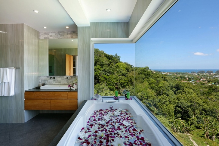 Glass wall and bathtub in Modern Villa Beyond in Phuket