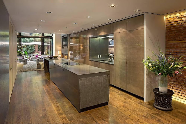 Brown modern kitchen in the Modern Townhouse With Loft Design