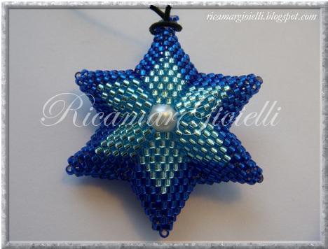 stella a 6 punte in peyote con perla centrale
