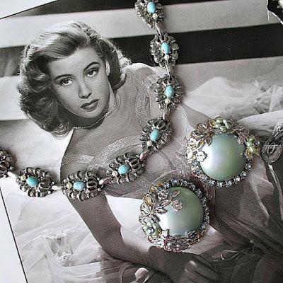 https://www.etsy.com/listing/242506983/elegant-vintage-necklace-earring-set-in?ref=shop_home_active_5