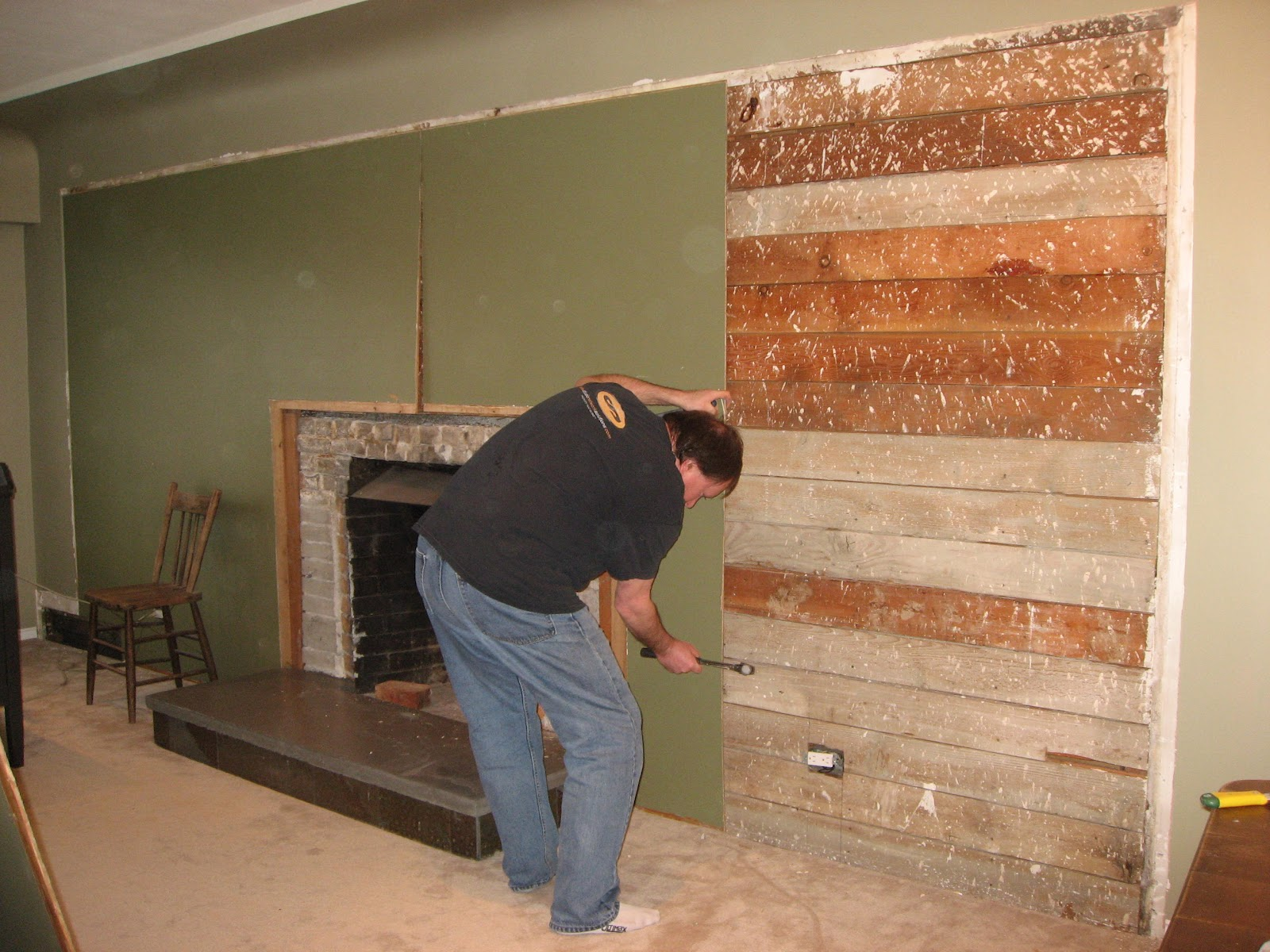 Heather 39 s home improvements livingroom fireplace remodel for T g wall panelling in bathroom