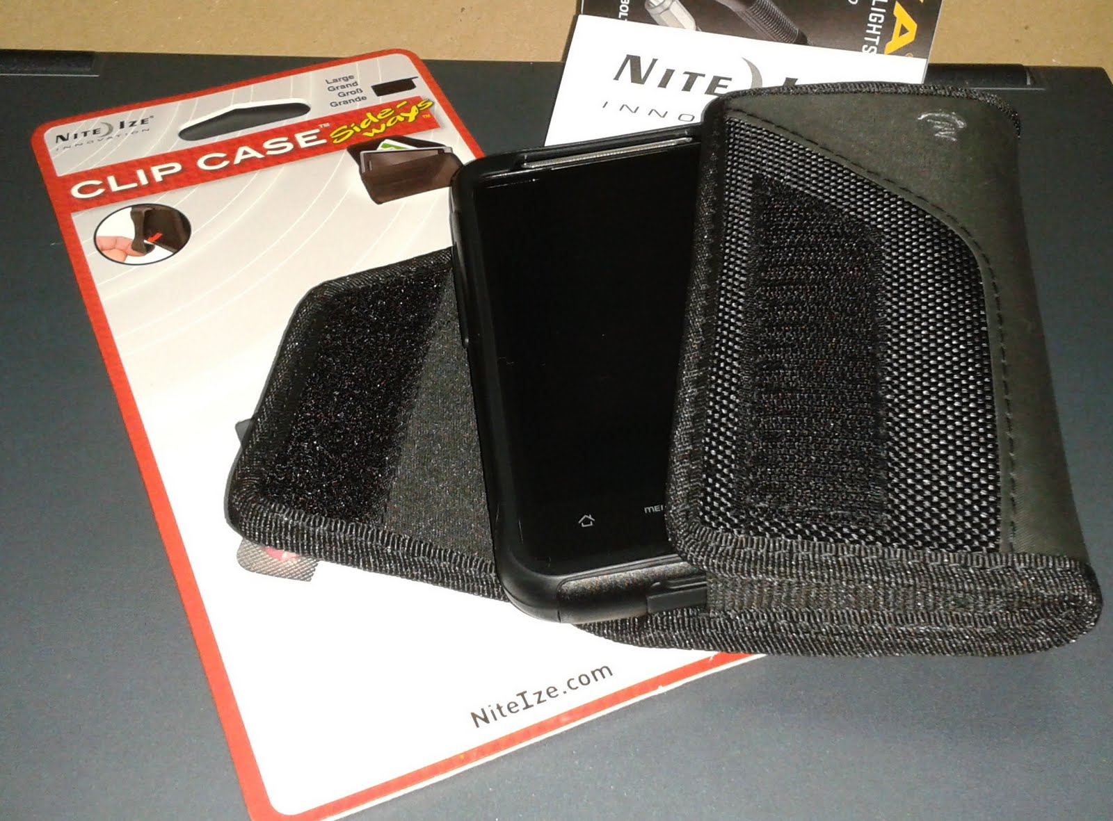 Going online, I found NiteIze's Large Clip Case Sideways. Fits