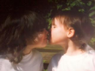 Twins kissing