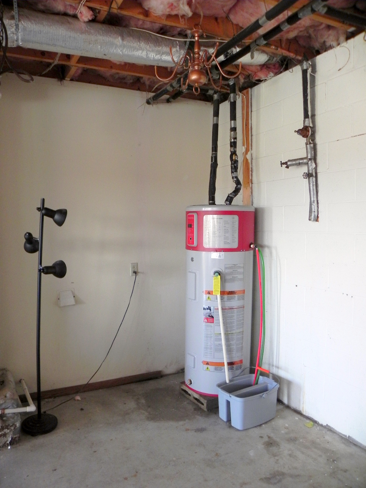 even tho it looks different it installed like any electric hot water heater the red portion is the heat pump and the red