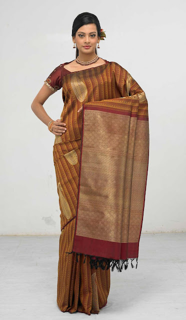 Marriage Sarees,Sarees,Saree, wedding sarees, kanchipuram silk sarees,Kanch Pattu Saree,New Indian Designer Collection of Bridal Sarees ,Cotton Sarees, Cotton Designer Saris,Cotton Sarees,bridal saree, wedding sari, party wear sarees, traditional indian sarees like zari, silk, printed,A perfect example of a traditional kanchipuram sari with a traditional look..yet elegant and stylish. I would love to accesorize like the lady in the picture above if I wear a Kanchipuram sari.. The pallu of this sari is really gorgeous with a lady standng in a red sari all hand woven and this sari is a very expensive one..I guess it costs more than  I simply adore this sari for its beautiful combination of colour, Orange and purple I'm still hunting for this combination but could not get the exact combination. This is simply adorable!!! another sari from RMKV silks.  This is a readymade sari for your little angel. This is a pure kanchipuram silk sari customized as a ready to wear outfit for small kids. I'm sure your little one's will be excited to wear this kutti pattu.. means saree for kid  The sari above is called the muppagam pattu the latest trend in Kanchipuram saris. You can see the border of the sari and the body in almost the same width. This sari is from Mahaveers a popular shop in Coimbatore THIS ONE IS A GADHWAL SILK, MY FAVOURITE BLUE.MY MOM IN LAW GIFTED ME. Sarees are the elegant and the sexiest outfit for Indian women. A lady looks very graceful and elegant in a saree.There are wide range of sarees in different materials and designs and work. The designer crepe,georgette and chiffons are popular these days and when it comes to a formal occassion my personal choice definitely would be traditional sarees specially kanchivaram sarees.One can choose kanchivaram sarees as per their own taste.The variety ranges from simple,elegant sarees to a very grand saree and the price range vary with the zari work in the saree. A simple saree with minimum zari work will cost any where be