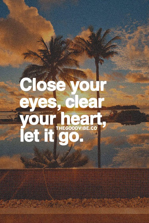 """Close your eyes, clear your heart, let it go."" Picture of a sunrise between two palm trees on a beach. thegoodvibe.co"