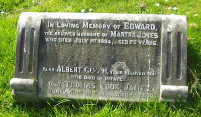 A colour photo of a low gravestone, only three names. In Loving Memory of Edward the beloved husband of Martha Joneswho died July 1st 1924, aged 75 years