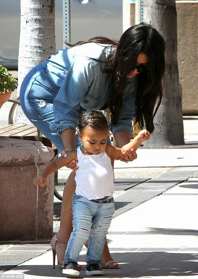 ... were joined by Kim's 35-year-old sister Kourtney as well as 58-year-old  momager Kris as they made their way to check-in to a hotel for the day. - Baby North West Is Rocking Ripped Jeans (Photos) - Nigerian