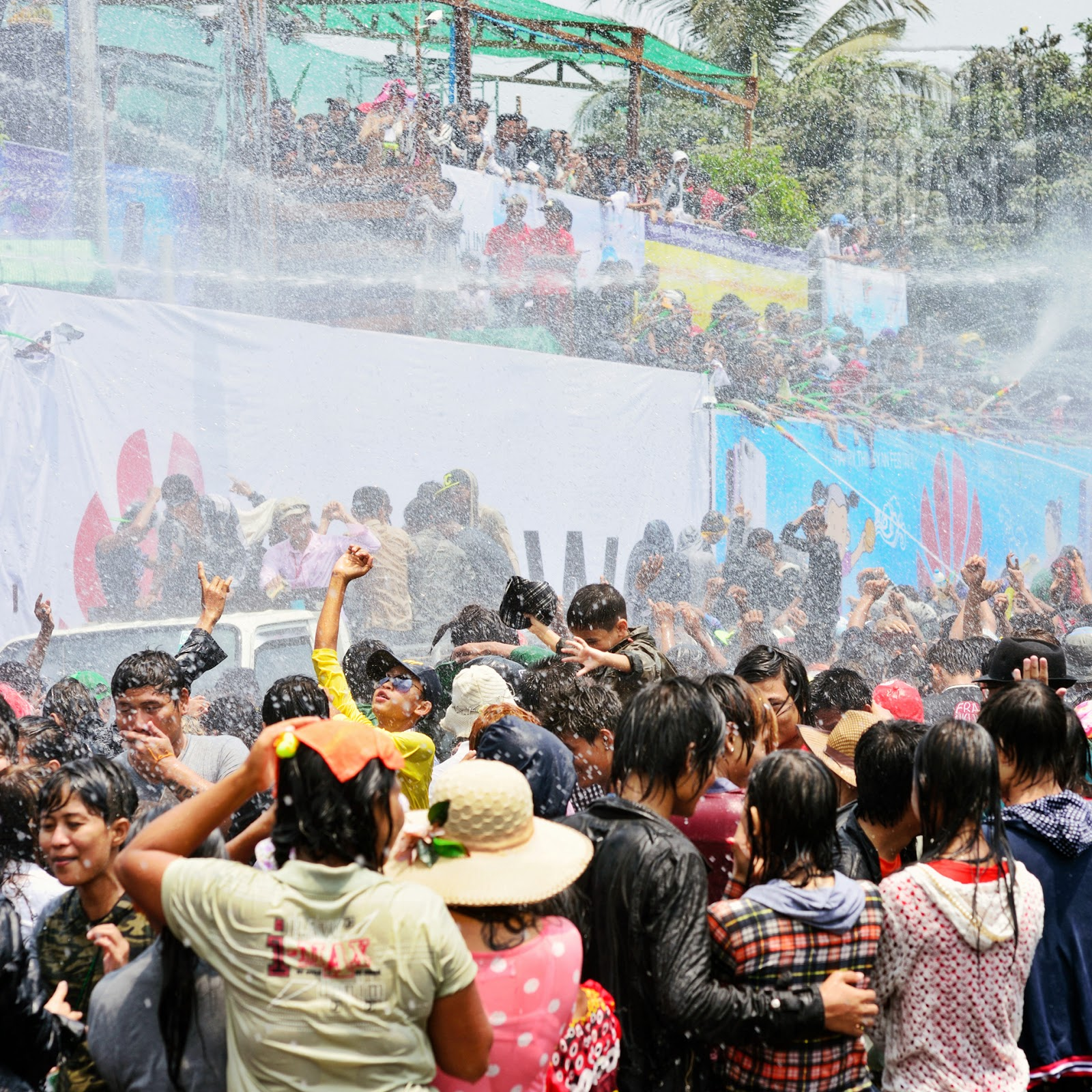 A crowd of people getting wet near Inya Lake, Yangon, during Myanmar's water festival.