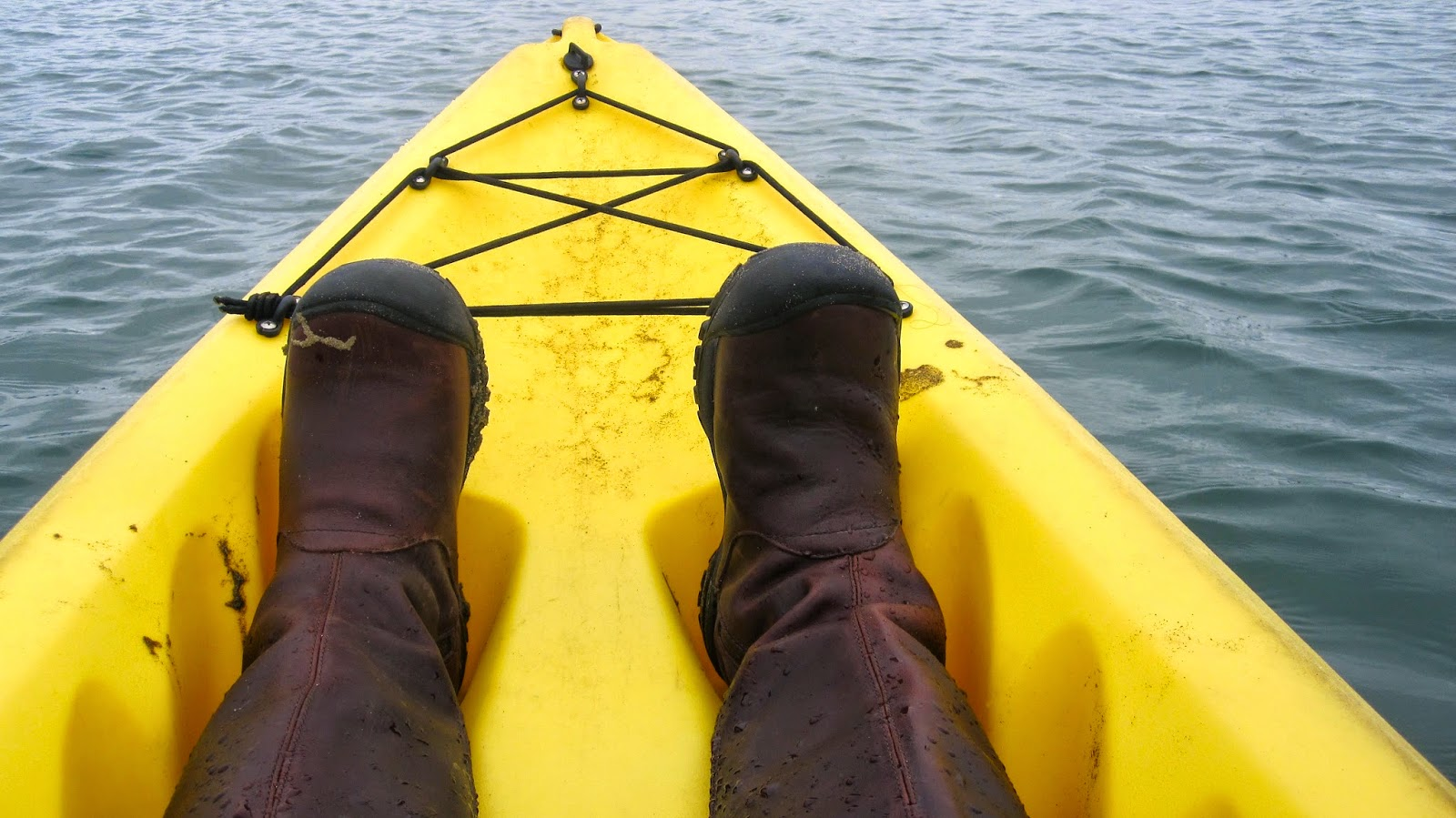 my feet in the kayak