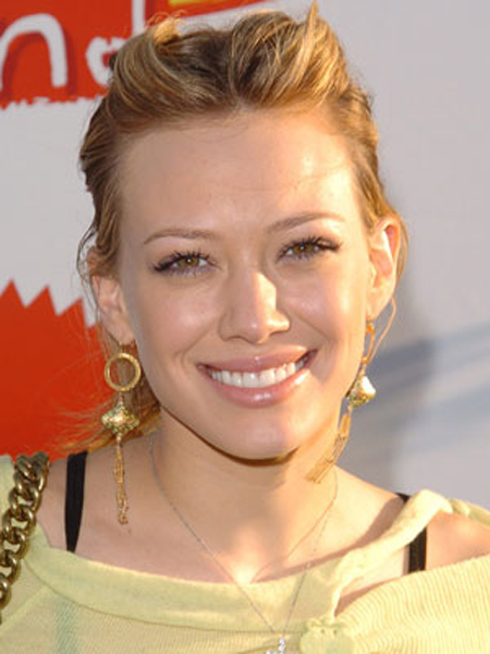 With twisted sections on top, Hilary Duff's tousled length is harnessed into a fun, texturized ponytail