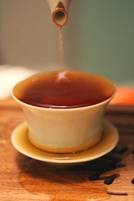 Overflowing cup of tea