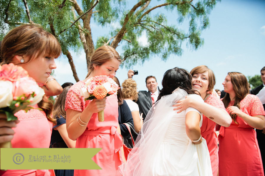 Bridesmaids hugs  : Photo by Paige and Blake Green