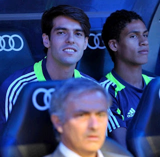 Varane at the Real Madrid bench alonside Kaka
