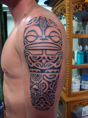 polynesian tiki tattoo half sleeve