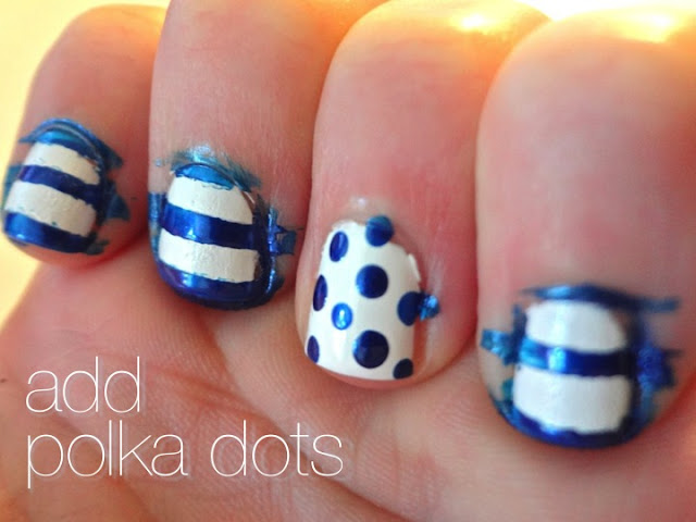 adding blue polka dots to accent nail