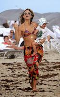 English: Molly Sims Flower Bikini 2014 New Year Eve Miami