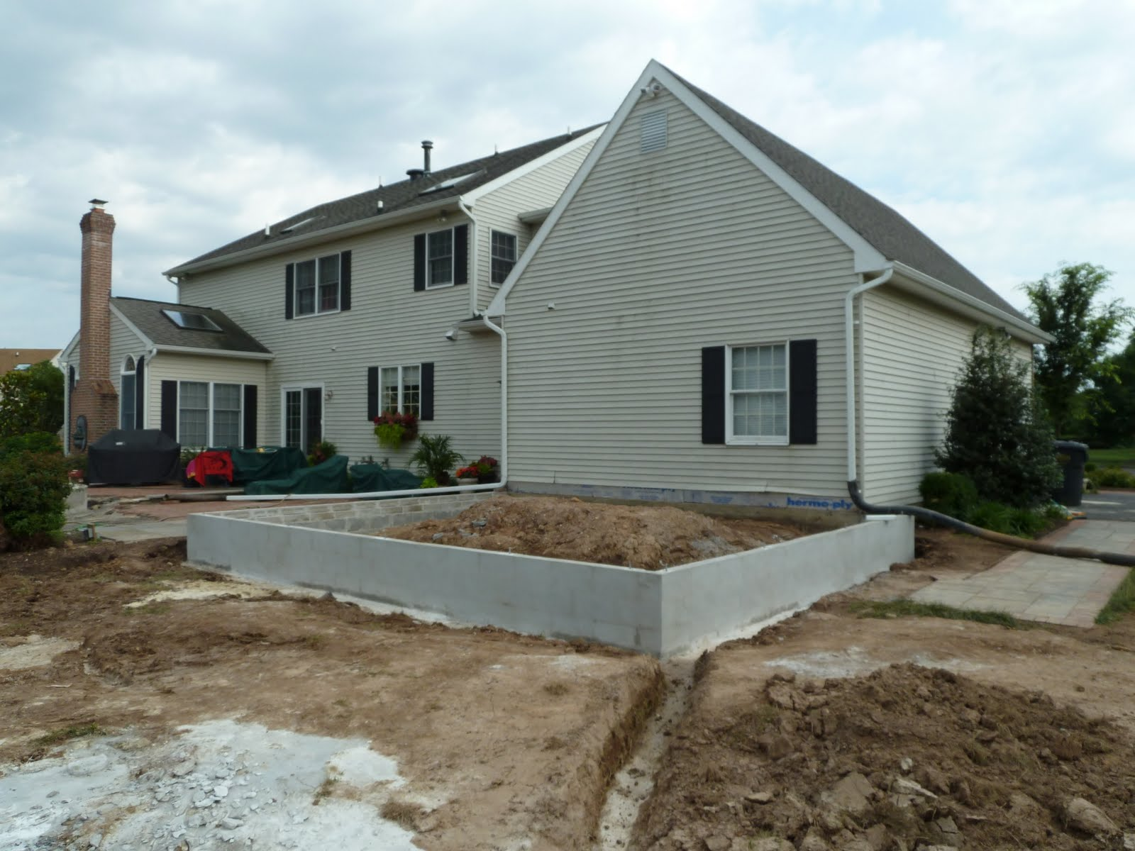 A e construction 39 s blog pool house addition first days for Pool house additions