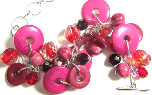 Bracelet has red and pink buttons with Fire Polished Czech Beads in pretty charm style design
