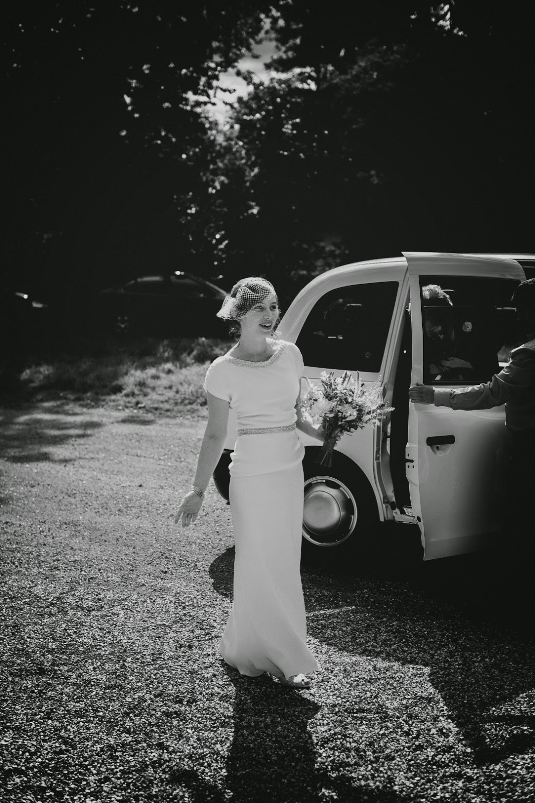 Real vintage bride Susie steps from the car, Heavenly Vintage Brides Wedding Blog