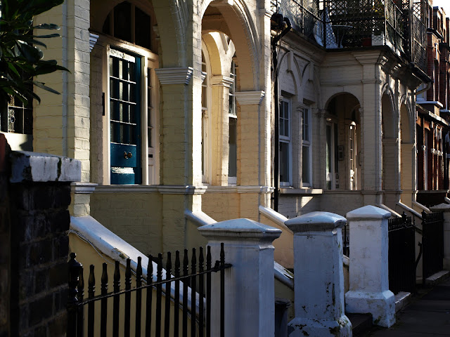 off the fulham road, splashes of morning sunlight on terraced houses