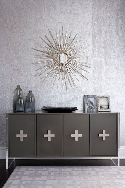 Modern charcoal grey buffet with a silver sunburst mirror