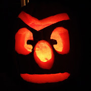 When Tom got home from hockey he was ready to carve his pumpkin.