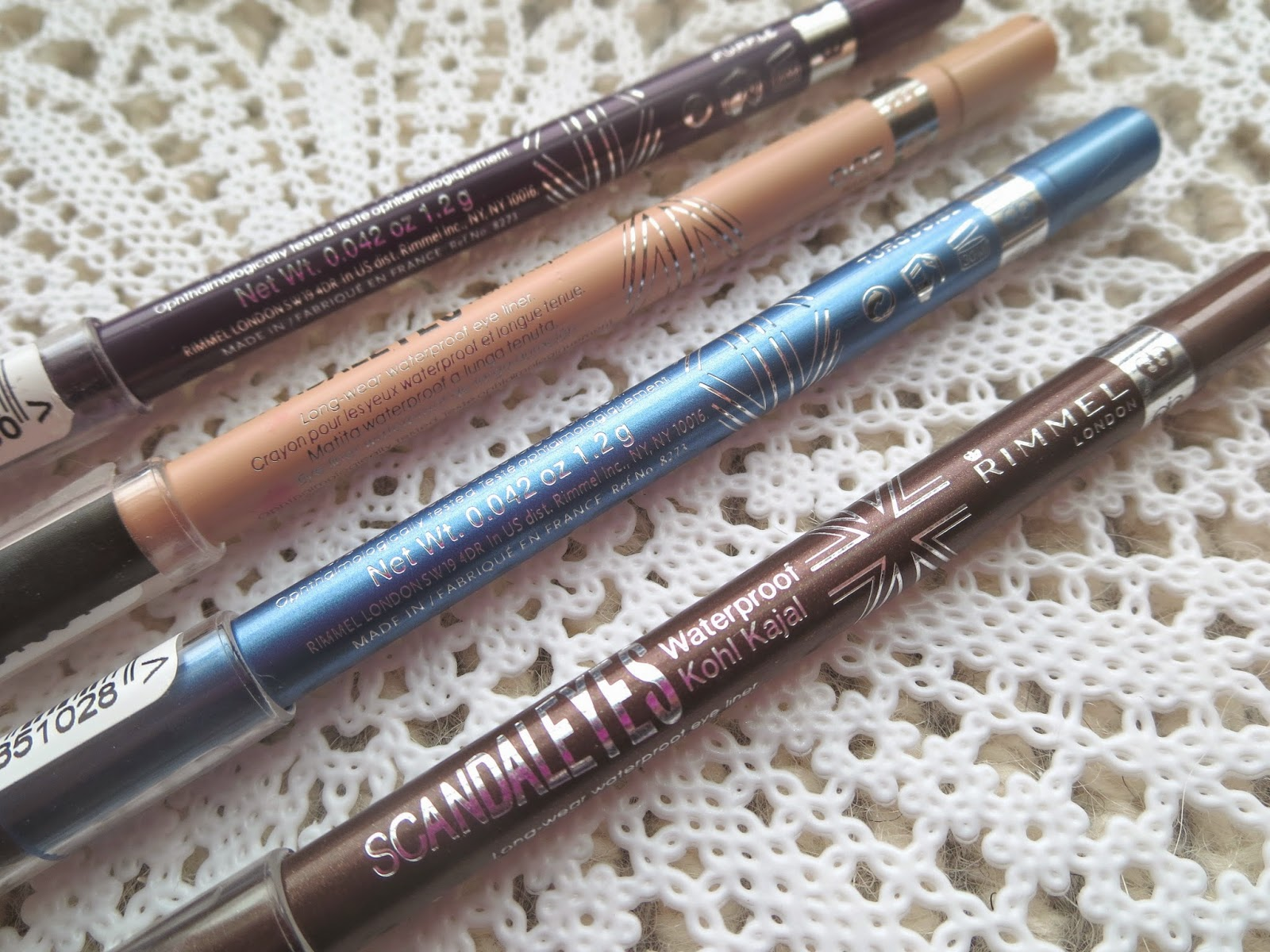 a picture of  Rimmel Scandaleyes Kohl Kajal in purple, nude, turquoise, brown