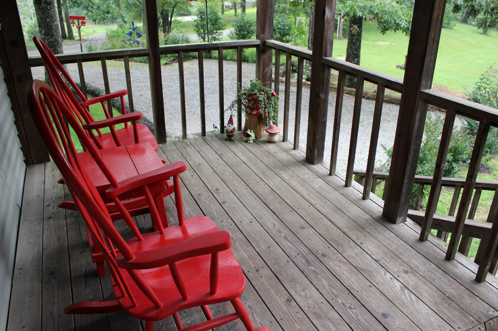 Red Oak Hollow Red Rocking chairs on the cottage porch