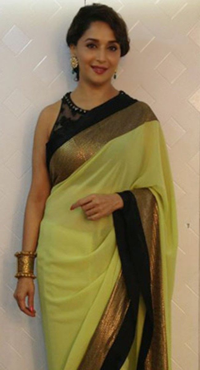 Beauty Queen Madhuri Dixit in a Black Border Green Saree and Netted Blouse