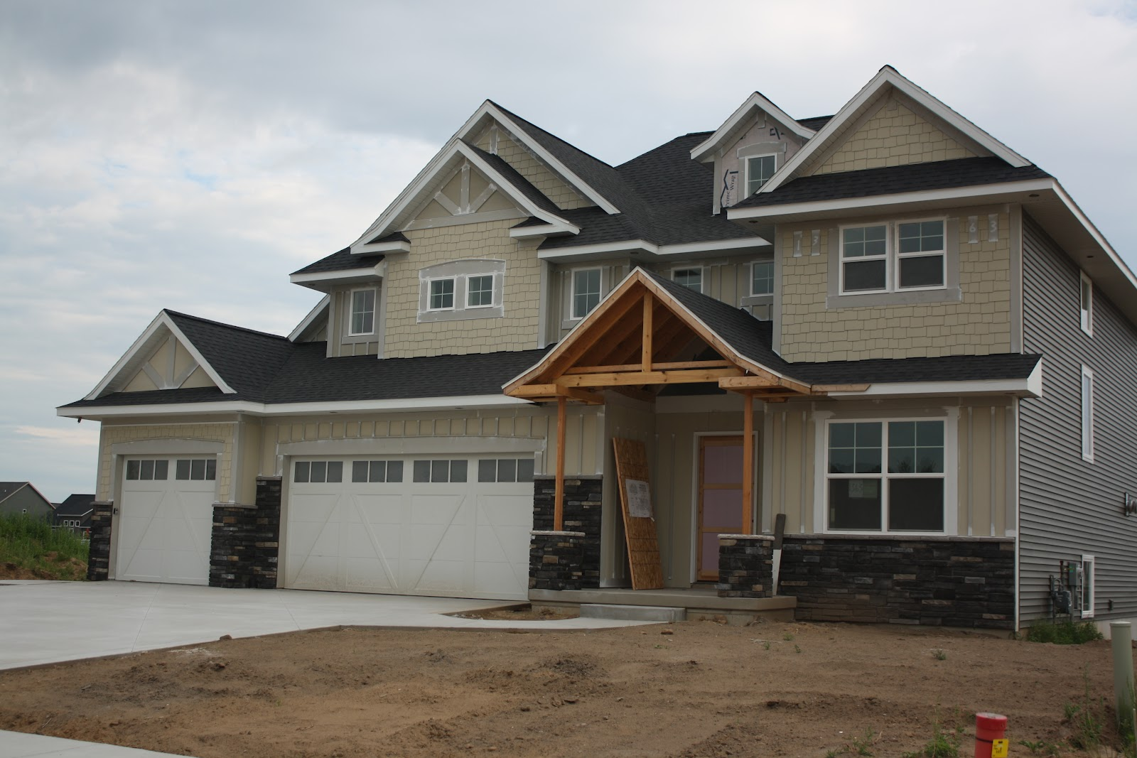 The Build: Exterior Stone, Siding, And Driveway Oh My! Part 93