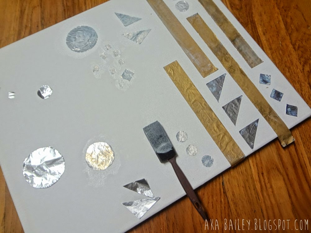 Gold and silver foil shapes on canvas