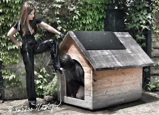 mistress with slave in rubber in a dog house