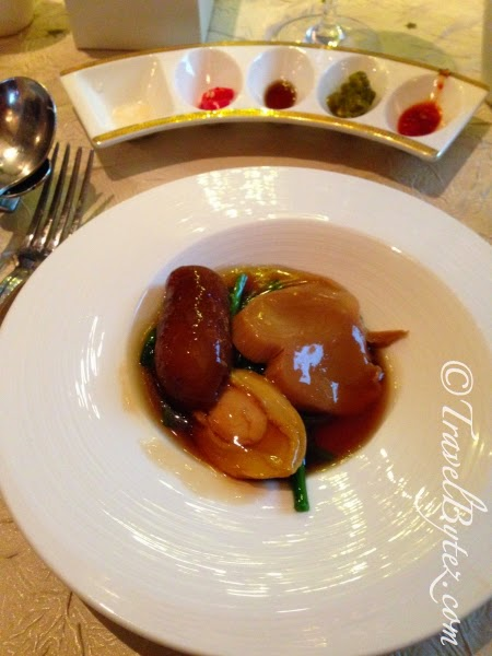 Braised baby abalone with sea cucumber, 'abalone' mushroom and seasonal greens