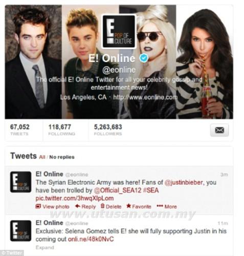 Paparan halaman Twitter E! Online yang menunjukkan akaun sosial laman web hiburan itu digodam oleh Tentera Elektronik Syria.