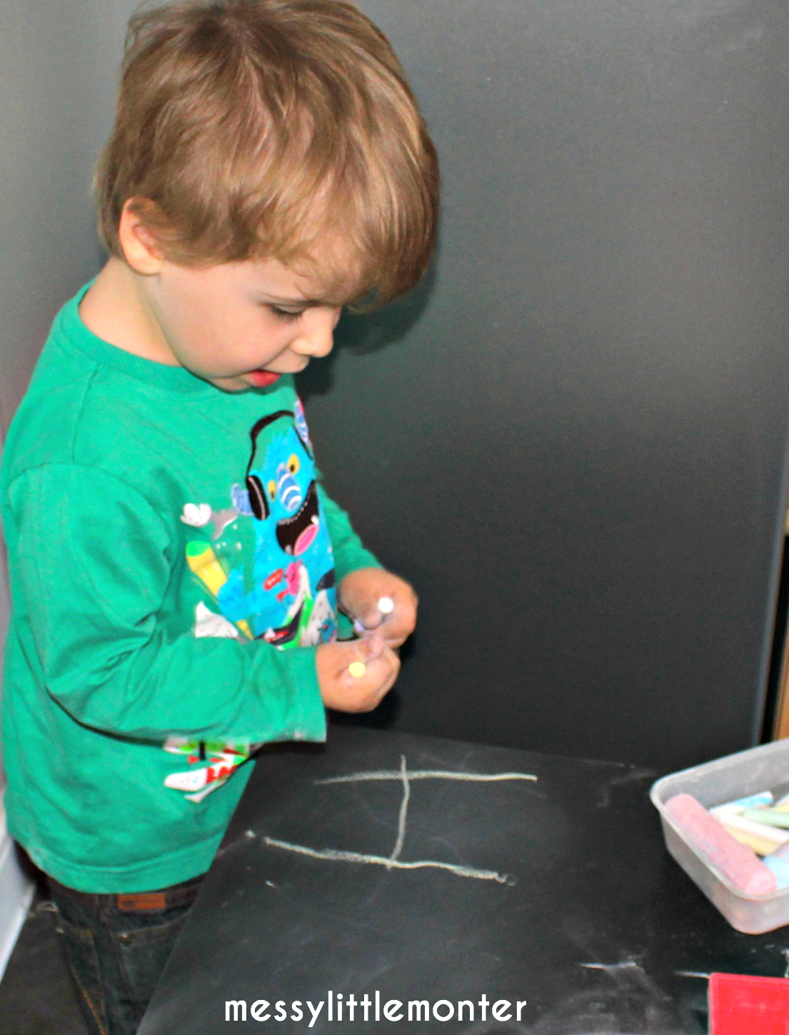 Learning letters on diy chalkboard table