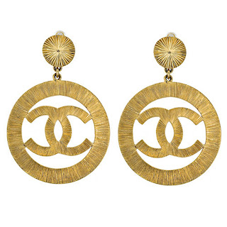 "Vintage 1990's large dangling Chanel gold ""CC"" logo earrings."