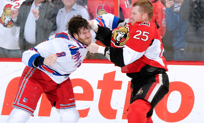 Rangers forward Brandon Prust and Ottawa's Chris Neil dropped the gloves in the first period of game 6