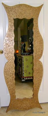 carved-swirl-design-mirror
