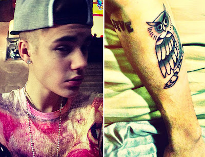 Justin Bieber shows his shaved head and new Owl tattoo to MTV