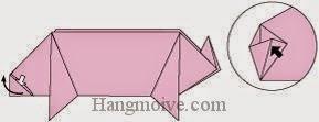 Bước 10: Từ vị trí mũi tên, mở lớp giấy ra, kéo và gấp lớp giầy về phía bên trái.