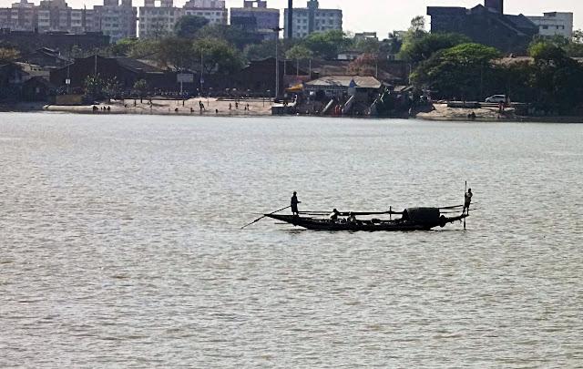 canoe silhouette Kolkata river