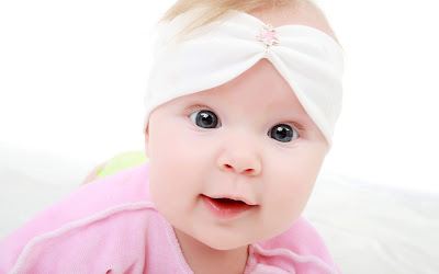 Cute Pink Baby With Beautiful Eyes Wallpaper