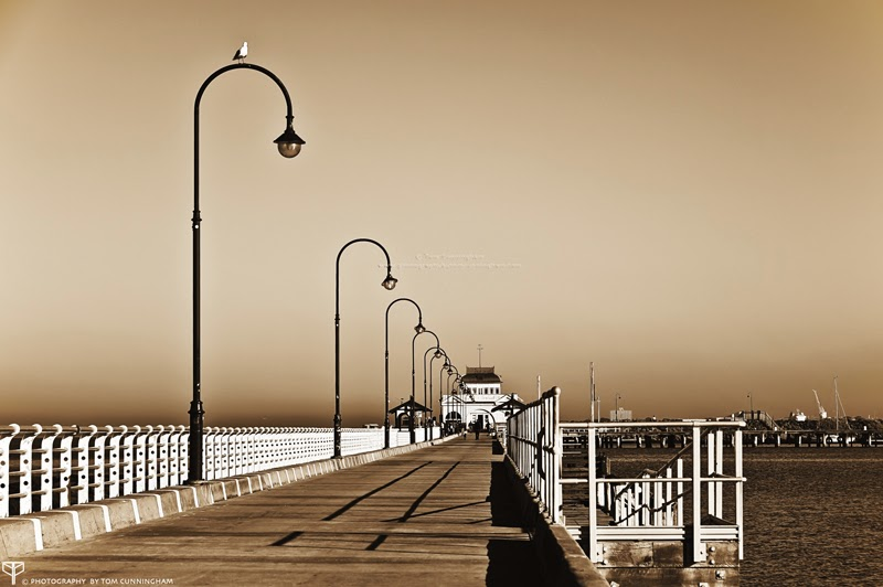 A sepia photograph by Tom Cunningham of St Kilda Pier in Melbourne
