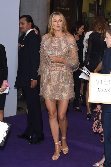 Maria Sharapova stunning leggy poses at WTA party carpet photo 8