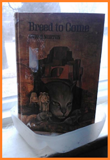 Andre Norton's Breed to Come is standing in a drainage pan made from the bottom of a milk jug.