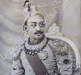Prabhu Narayan Singh, Maharaja of Benares, c. 1900, wears a striking array of royal jewels, mostly emeralds and diamonds. His gem-studded epaulettes are fringed with seed pearls.