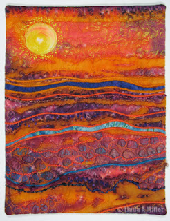 orange purple landscape quilt with yellow sun, undulating lines
