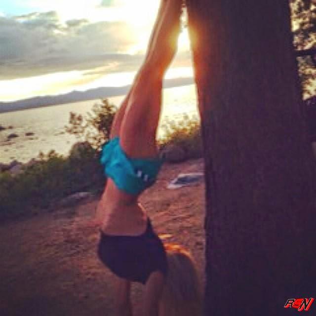 Torrie Wilson Doing Handstands.