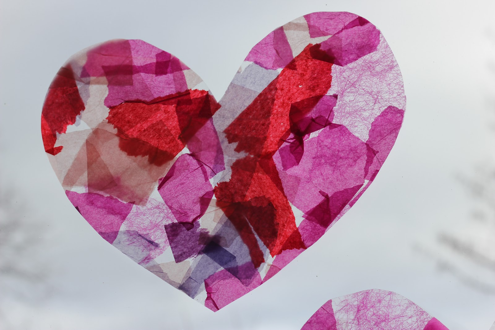 Tissue paper stained glass hearts the imagination tree for Stained glass window craft with tissue paper